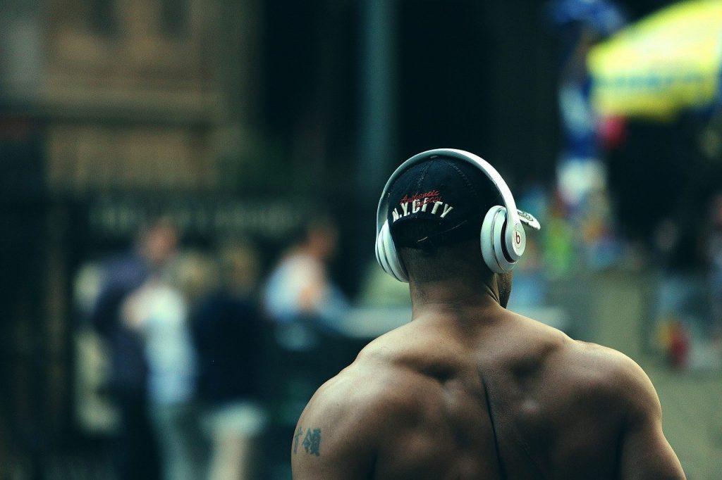 A man wearing beats headphones.