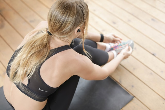 The Best Checklist. Woman working out with wireless headphones in.