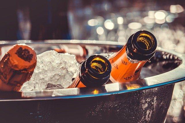 Beer bottles sitting in an ice bath.