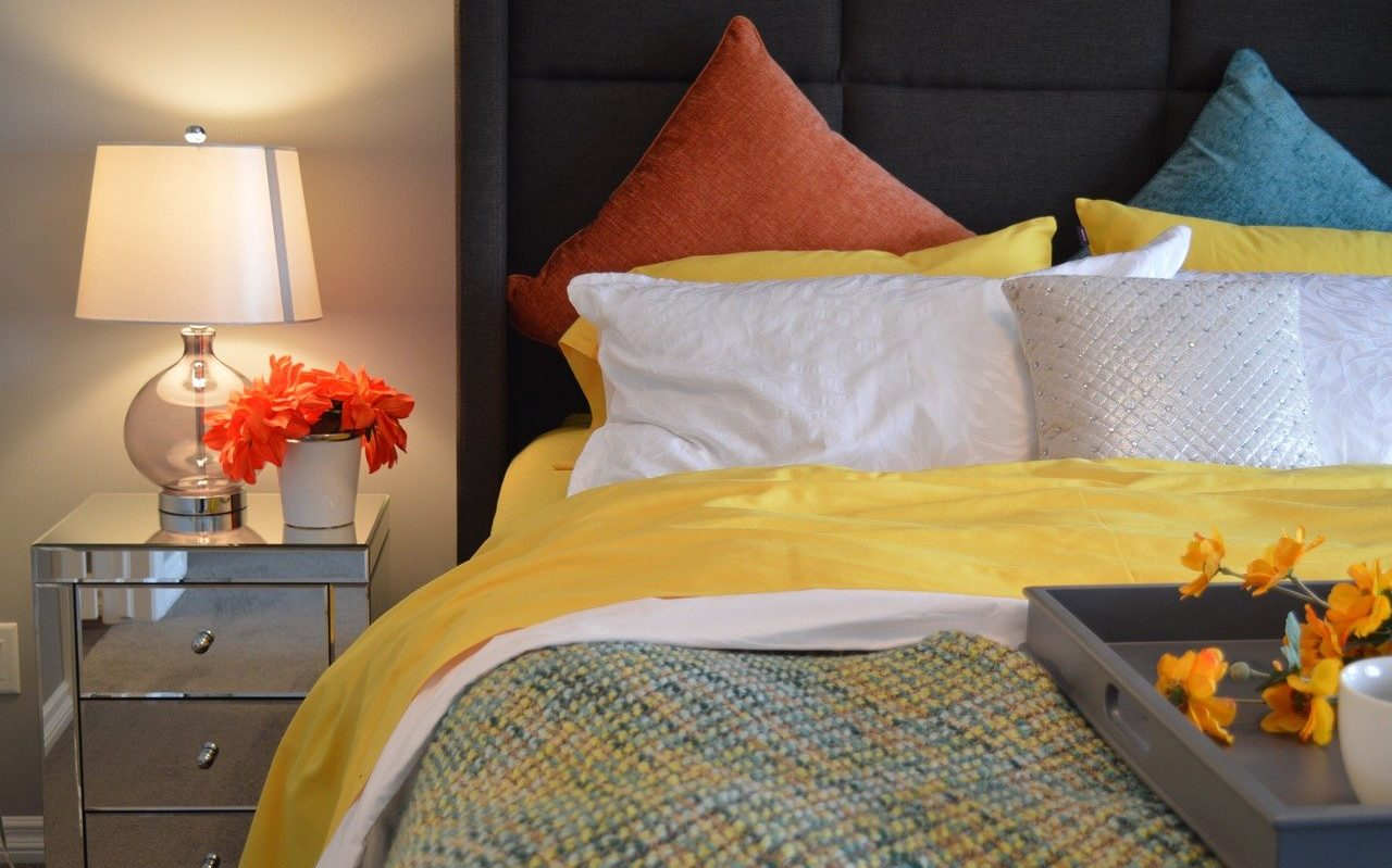 Yellow comforter with a quilt