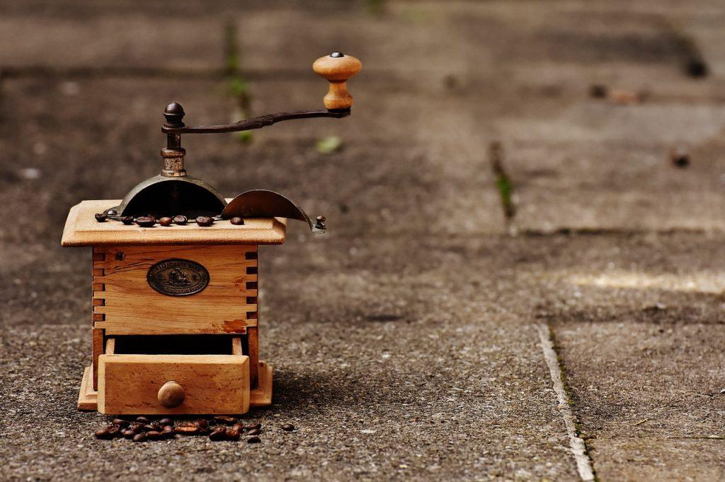 A coffee grinder on a street.