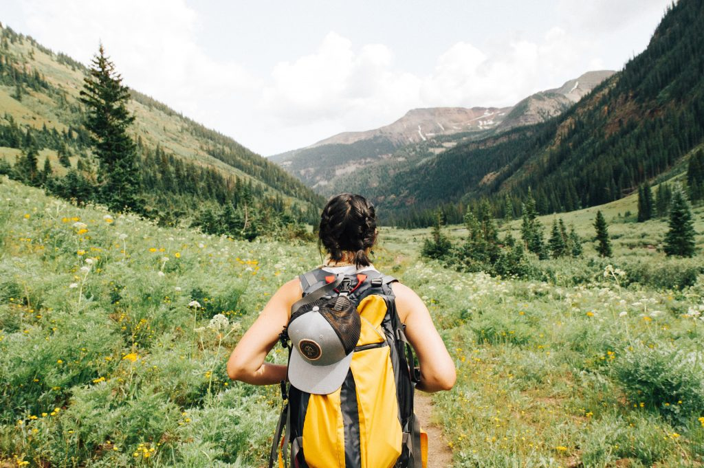 A person hiking in a valley