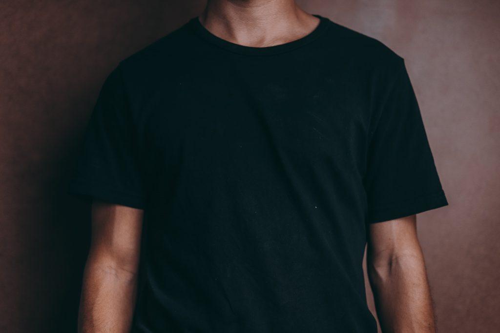 A person wearing a black shirt