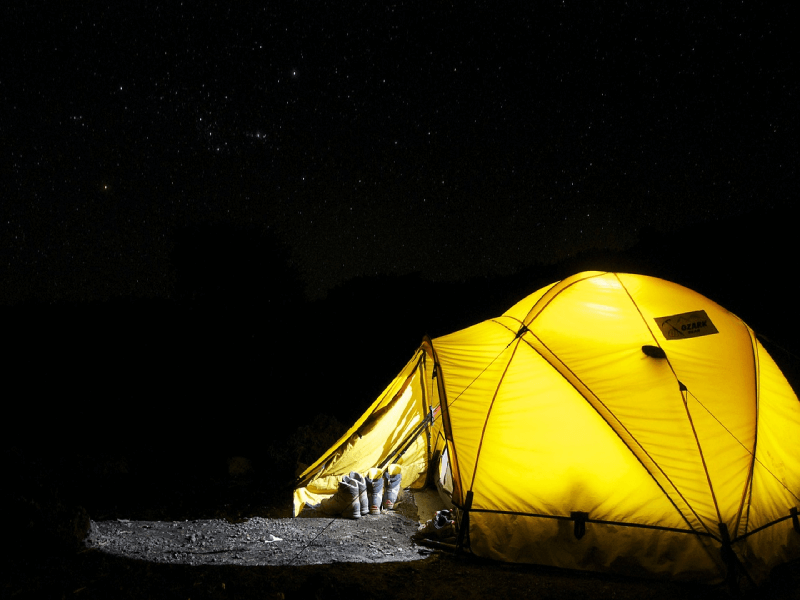 Tent lit up on starry night