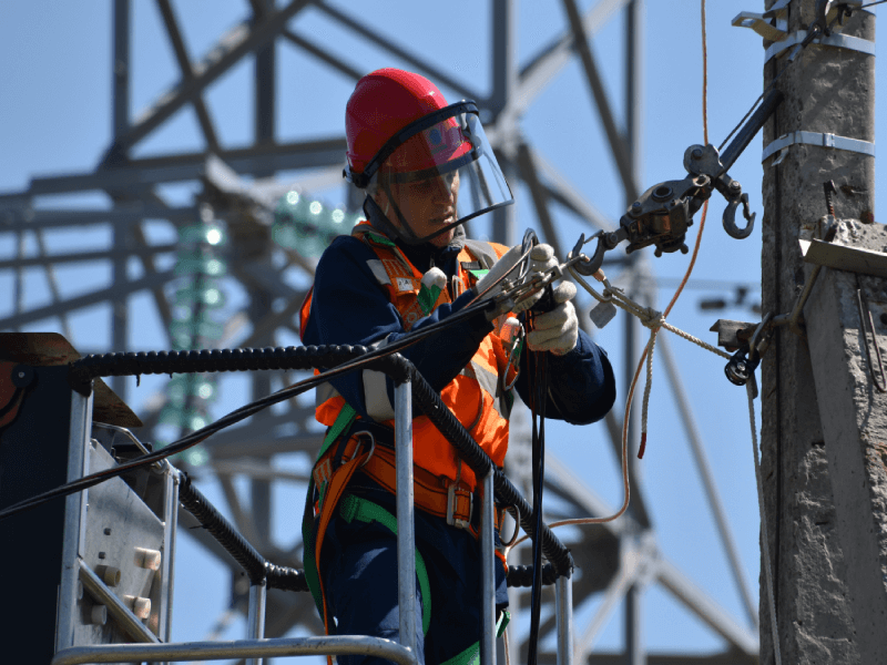 Electrician working on a power line