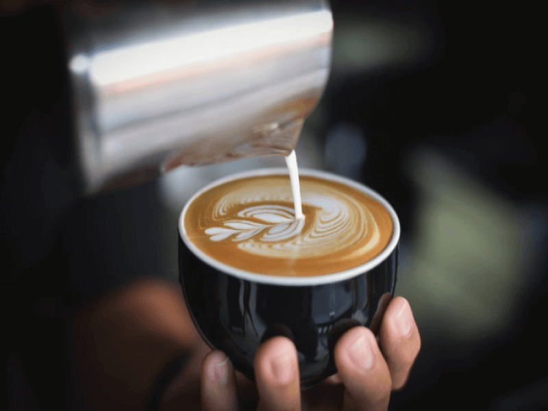 Milk foam being poured into latte art