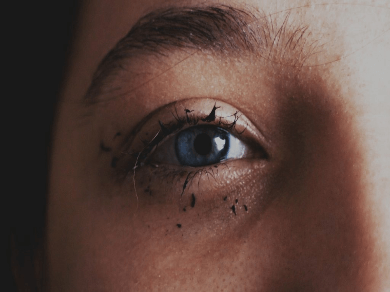 A woman with mascara on.