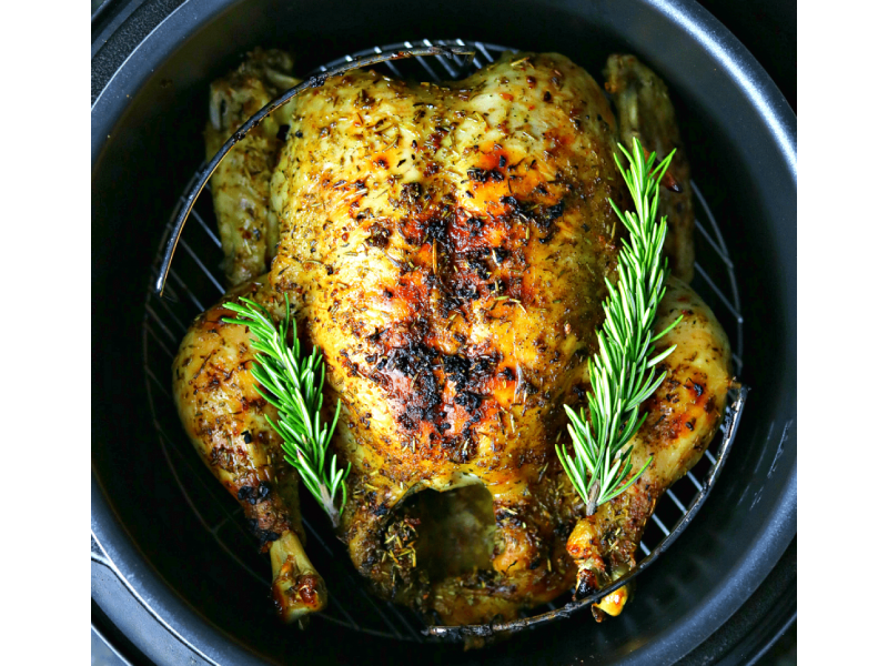 A roasted chicken with herbs.