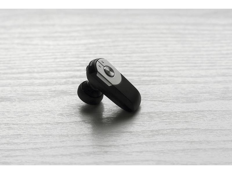 A singular black headphone.