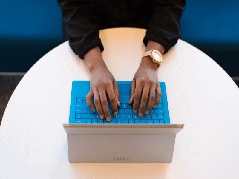 typing on a blue keyboard