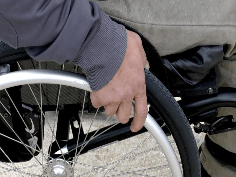 man holding wheelchair